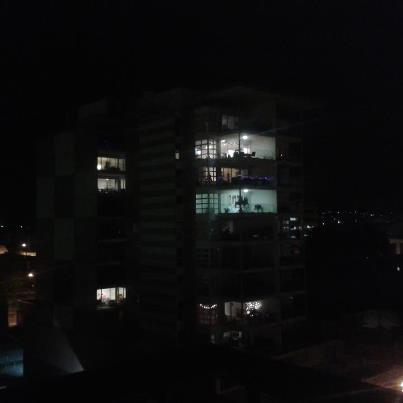 ACROSS THE WAY: Apartments with their lights on.