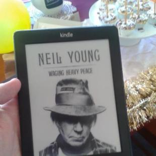 YOUNG AT HEART: My birthday present from my gorgeous de facto was Neil Young's autobiography loaded on to a spanking new Kindle. I'm officially a futurist.