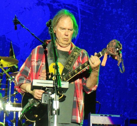 SHOWING SUPPORT: Neil Young drapes my friend Mel's bra over his legendary 'Old Black' guitar. It was for his encore of 'Roll Another Number'.
