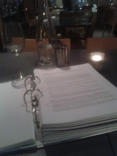 WINE AND PROOFING: An image taken during the proofing of one of Enormity's drafts.