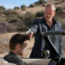 LIVING BY THE GUN: Farrell and Woody Harrelson.