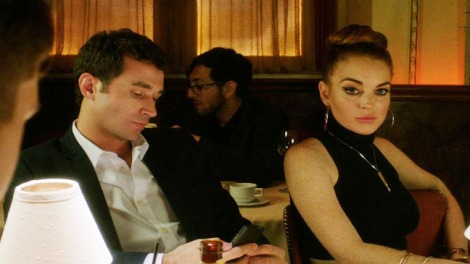POLITE SOCIETY: James Deen and Linsday Lohan fein interest during the opening scene of The Canyons.