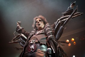 FEEDING TIME: Alice Cooper dons his spider costume.