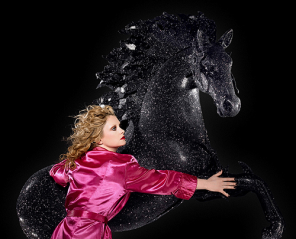 NIGHT MARE: Alison Goldfrapp. of Goldfrapp, hugs a horse.